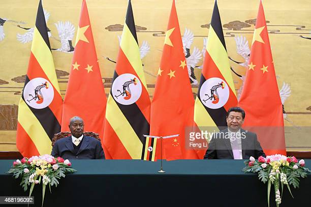 Ugandan President Yoweri Kaguta Museveni and Chinese President Xi Jinping attend a signing ceremony in the Great Hall of the People on March 31 2015...