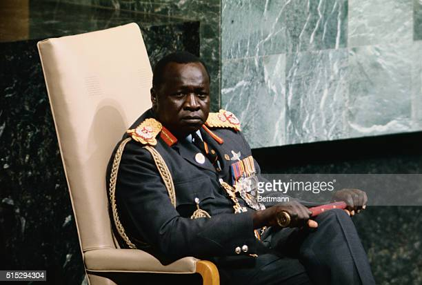 Ugandan PresidentforLife Idi Amin sits listening to the text of his speech being delivered by the Ugandan UN ambassador Amin's brief introduction was...