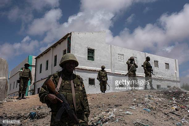 Ugandan soldiers deployed with the African Union Mission in Somalia look at the beach in Barawe on October 11 2016 in Barawe Somalia The city of...