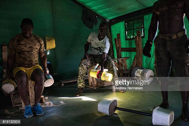 Ugandan soldiers in the 17th Battle Group of the African Union Mission in Somalia's Forward Operating Base Barawe work out in the base's gym on...