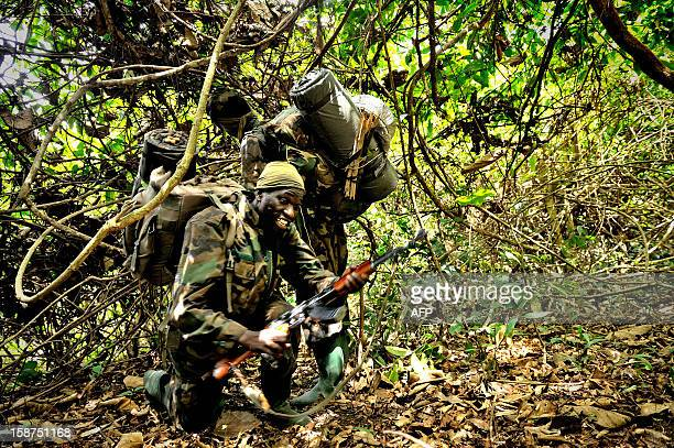 Ugandan soldiers patrol on April 18 2012 through the central African jungle during an operation to fish out notorious Lord's Resistance Army leader...