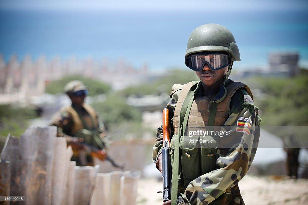 Ugandan soldiers watch Al Shabaab positions on the frontline in Karaan district on February 20 2012 in Mogadishu Somalia As operations against Al...