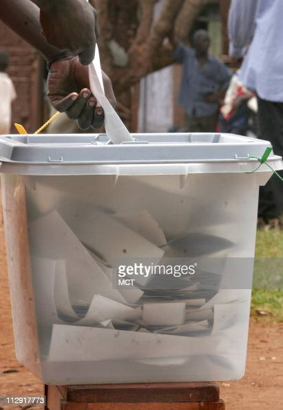 Ugandans cast their votes for president in clear ballot boxes in an effort to prevent vote rigging at a polling station in Jinja Uganda Thursday...