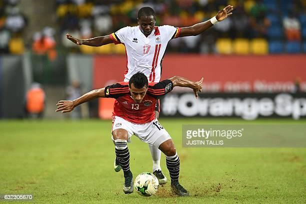 TOPSHOT Uganda's forward Farouk Miya challenges Egypt's defender Mohamed AbdelShafy during the 2017 Africa Cup of Nations group D football match...