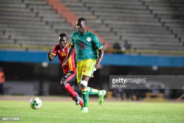 Uganda's Muleme Issac an Senegal's Elh Babacar Khouma compete during the friendly football match Senegal vs Uganda at the Leopold Sedar Senghor...
