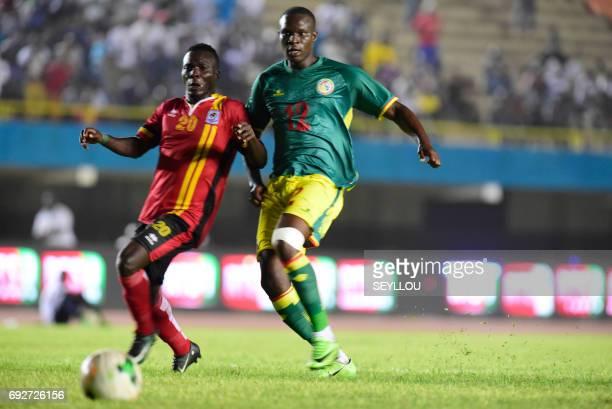 Uganda's Muleme Issac vies for the ball with Senegal's Elh Babacar Khouma during their friendly football match Senegal vs Uganda at the Leopold Sedar...