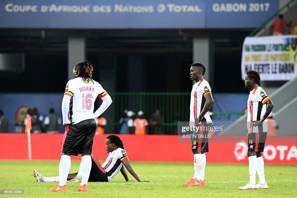 Uganda's players react at the end of the 2017 Africa Cup of Nations group D football match between Egypt and Uganda in Port-Gentil on January 21, 2017. / AFP / Justin TALLIS