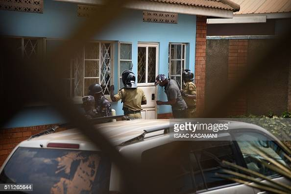 Uganda's policemen search for top presidential challenger Kizza Besigye at the Forum for Democratic Change offices on February 19 2016 in Kampala as...