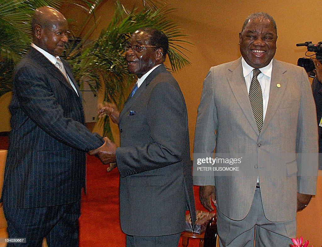 Uganda's President Yoweri Museveni receives his Zimbabwean and Zambian counterparts Robert Mugabe and Rupiah Banda respectively in Kampala before the...