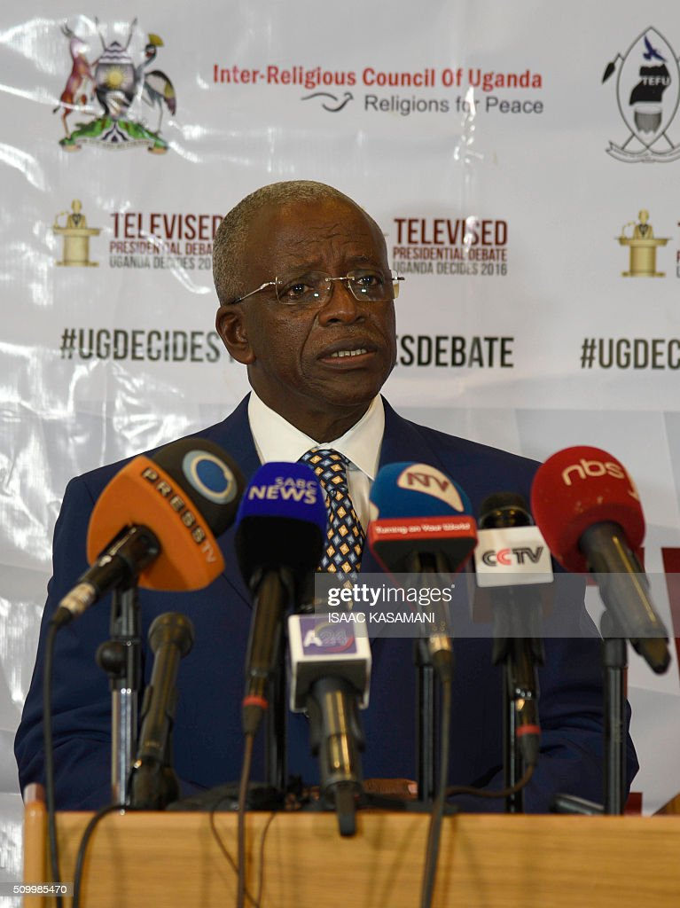 Ugandas Presidential Candidate Amama Mbabazi, address the media in Kampala on February 13, 2016. The press conference took place before all the presidential candidates joined for the Inter-Religious Council of Uganda organised debate in the Capital Kampala. / AFP / Isaac Kasamani