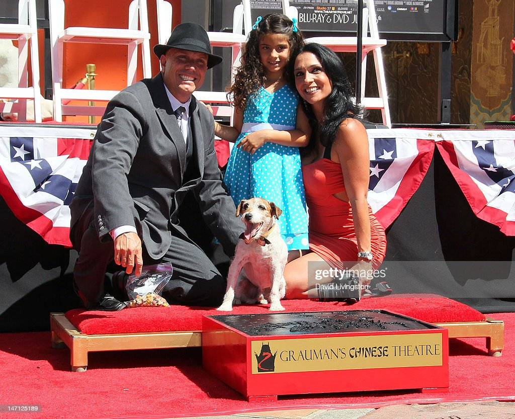 Uggie's owner/trainer Omar von Muller and family pose with the dog from 'The Artist' which won an Academy Award for Best Picture after Uggie being immortalized with a hand and paw print ceremony at Grauman's Chinese Theatre on June 25, 2012 in Hollywood, California.