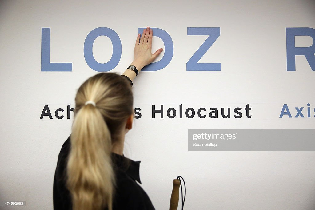 Ugne Metzner, who has been blind due to an illness since she was 21, feels her way along the tactile lettering of Holocaust concentration camp locations in a corridor at the Jewish Museum Berlin on February 21, 2014 in Berlin, Germany. Metzner was participating in the first organized architectural tour of the museum for blind people. The tours, which will be offered four times a year but can also be booked on other occasions, are geared specifically to what a blind person would be most able to appreciate in the building known for its tilted planes and narrowing spaces and designed by American architect Daniel Libeskind.