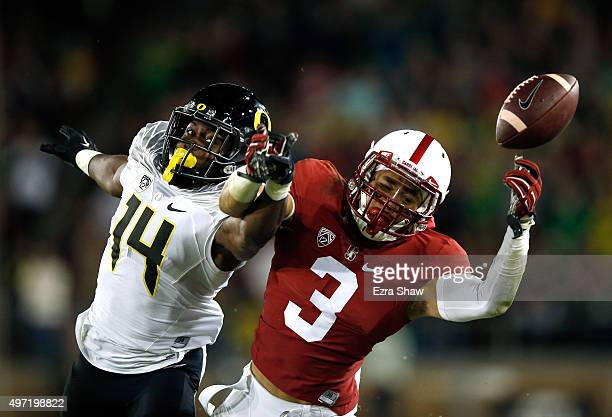 Ugo Amadi of the Oregon Ducks breaks up a pass intended for Michael Rector of the Stanford Cardinal at Stanford Stadium on November 14 2015 in Palo...