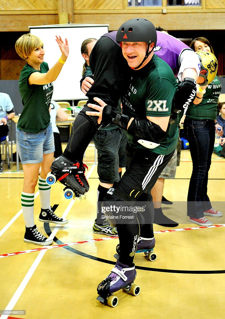Ugo Boss of New Wheeled Order carries Eves-Ormal of Linconshire Rolling Thunder in the Men's European Cup roller derby tournament at Walker Activity Dome on August 31, 2014 in Newcastle upon Tyne, England.