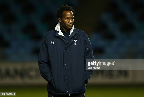Ugo Ehiogu coach of Tottenham Hotspur looks on as players warm up during the Premier League 2 match between Manchester City and Tottenham Hotspur at...