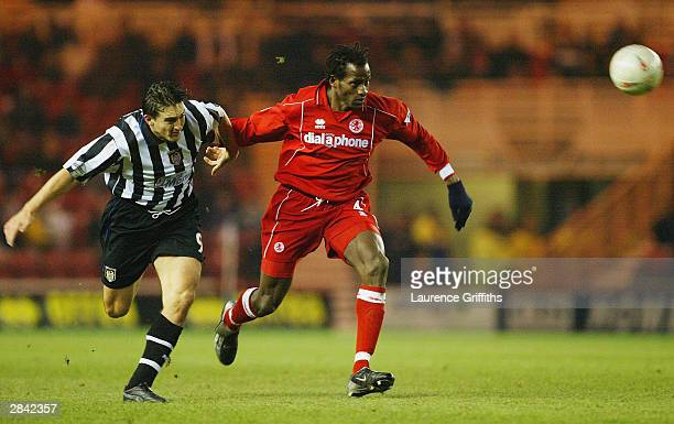 Ugo Ehiogu of Middlesbrough battles for the ball with Mark Stallard of Notts County during the FA Cup Third Round match between Middlesbrough and...
