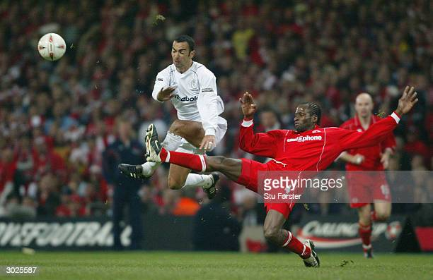 Ugo Ehiogu of Middlesbrough battles for the ball with Youri Djorkaeff of Bolton Wanderers during the Carling Cup Final match between Bolton Wanderers...