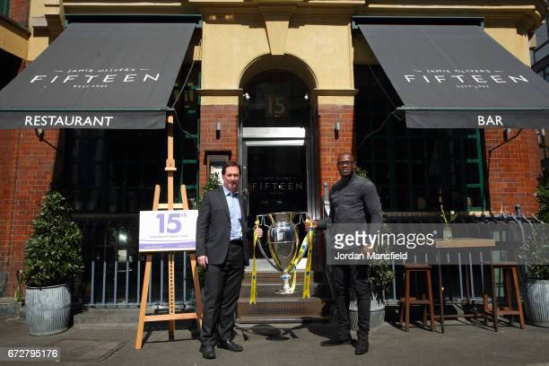 Ugo Monye and Mark McCafferty pose for a photo with the Premiership Trophy during the Media Lunch to celebrate the 15th Premiership Rugby Final With...