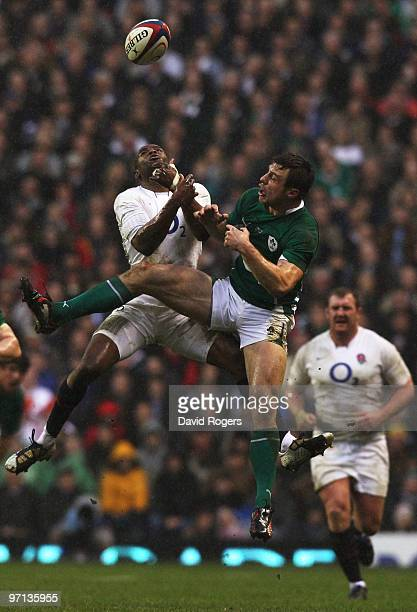Ugo Monye of England and Tommy Bowe of Ireland challenge for the ball in the air during the RBS Six Nations match between England and Ireland at...