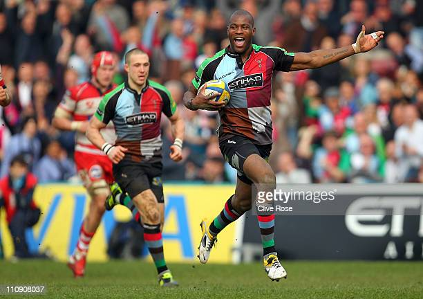 Ugo Monye of Harlequins celebrates on his way to scoring a breakaway try during the Aviva Premiership match between Harlequins and Gloucester at The...