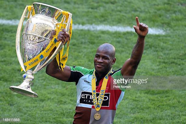 Ugo Monye of Harlequins celebrates with the trophy following his team's victory during the Aviva Premiership final between Harlequins and Leicester...