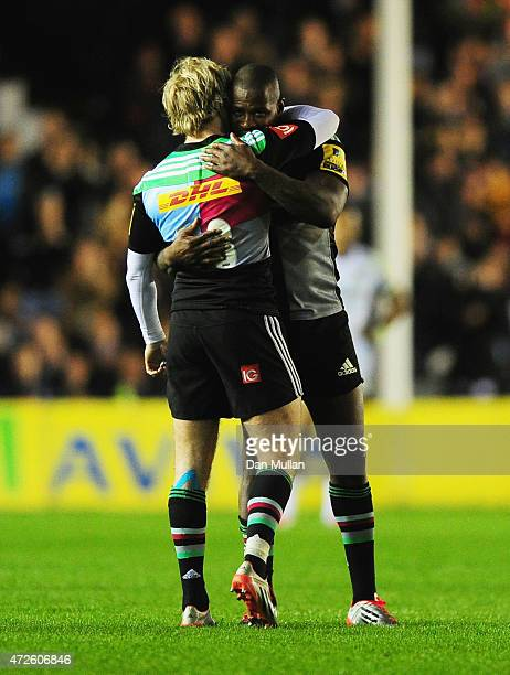 Ugo Monye of Harlequins embraces team mate Charlie Walker as he leaves the field during the Aviva Premiership match between Harlequins and Bath Rugby...