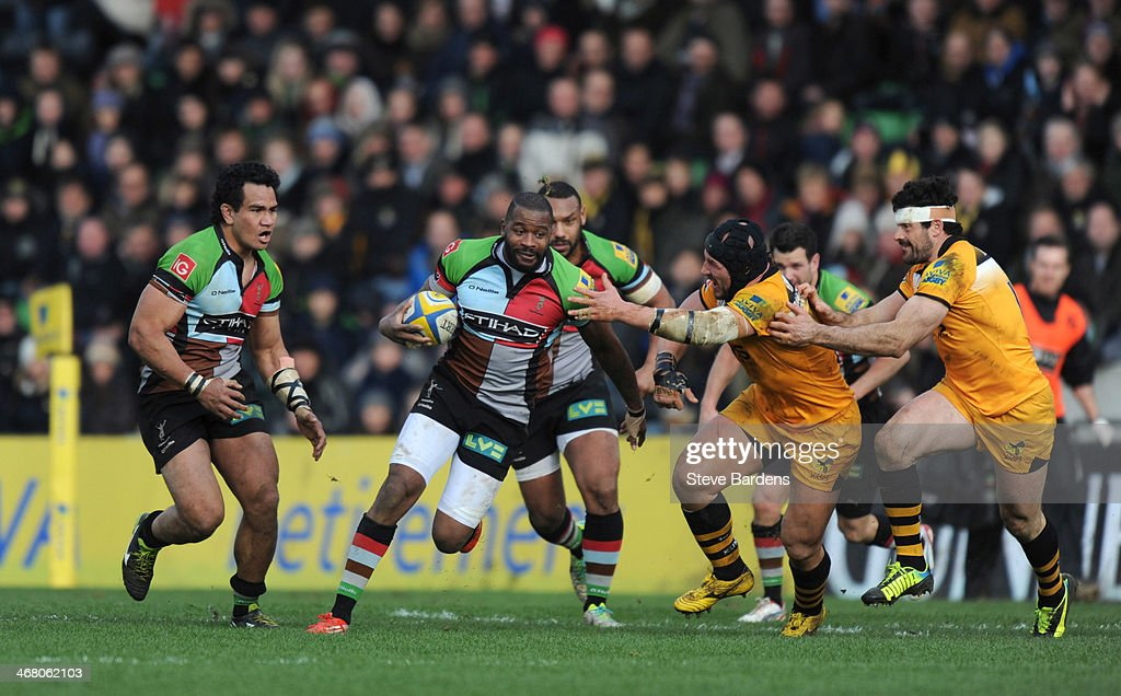 <a gi-track='captionPersonalityLinkClicked' href=/galleries/search?phrase=Ugo+Monye&family=editorial&specificpeople=221264 ng-click='$event.stopPropagation()'>Ugo Monye</a> of Harlequins hands off <a gi-track='captionPersonalityLinkClicked' href=/galleries/search?phrase=James+Haskell&family=editorial&specificpeople=539694 ng-click='$event.stopPropagation()'>James Haskell</a> of London Wasps during the Aviva Premiership match between Harlequins and London Wasps at Twickenham Stoop on February 9, 2014 in London, England.