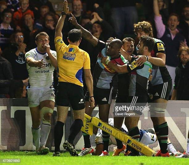 Ugo Monye of Harlequins is mobbed by team mates after scoring his second try during the Aviva Premiership match between Harlequins and Bath at the...