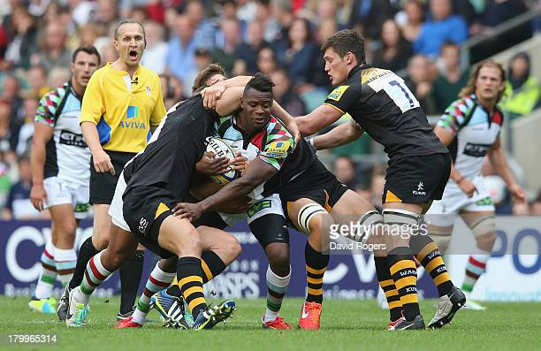 Ugo Monye of Harlequins is stopped by the Wasps defence during the Aviva Premiership match between London Wasps and Harlequins at Twickenham Stadium...