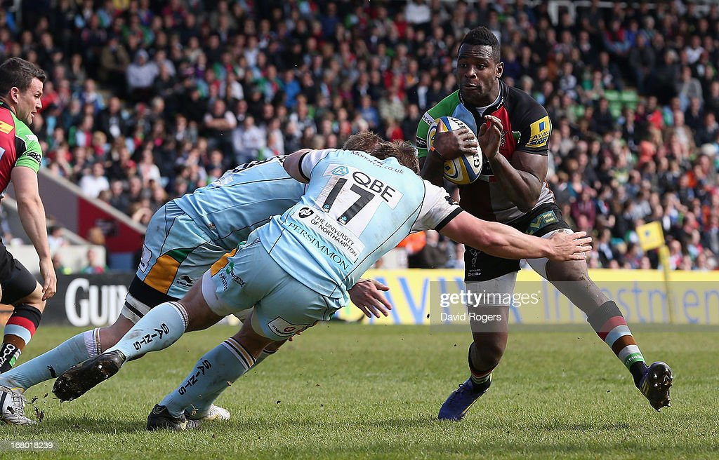 <a gi-track='captionPersonalityLinkClicked' href=/galleries/search?phrase=Ugo+Monye&family=editorial&specificpeople=221264 ng-click='$event.stopPropagation()'>Ugo Monye</a> of Harlequins is tackled by Alex Waller during the Aviva Premiership match between Harlequins and Northampton Saints at Twickenham Stoop on May 4, 2013 in London, England.