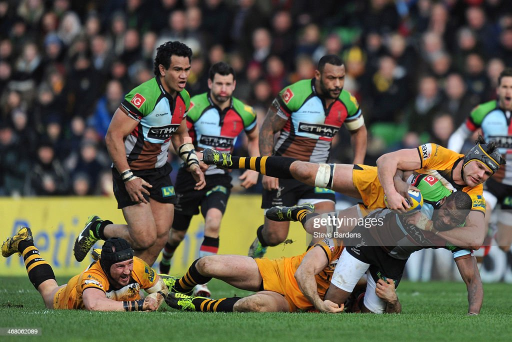 <a gi-track='captionPersonalityLinkClicked' href=/galleries/search?phrase=Ugo+Monye&family=editorial&specificpeople=221264 ng-click='$event.stopPropagation()'>Ugo Monye</a> of Harlequins is tackled by <a gi-track='captionPersonalityLinkClicked' href=/galleries/search?phrase=Tom+Palmer&family=editorial&specificpeople=233666 ng-click='$event.stopPropagation()'>Tom Palmer</a> of London Wasps during the Aviva Premiership match between Harlequins and London Wasps at Twickenham Stoop on February 9, 2014 in London, England.