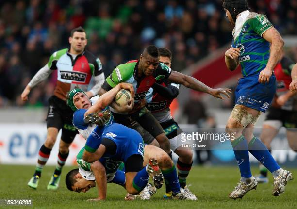 Ugo Monye of Quins is tackled during the Heineken Cup match between Harlequins and Connacht Rugby at Twickenham Stoop on January 12 2013 in London...