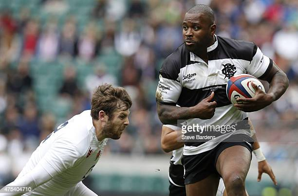 Ugo Monye of the Barbarians makes a break during the match between the Barbarians and England XV at Twickenham Stadium on May 31 2015 in London...