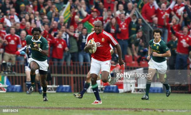 Ugo Monye of the Lions races away to score a breakaway try during the Third Test match between South Africa and the British and Irish Lions at Ellis...