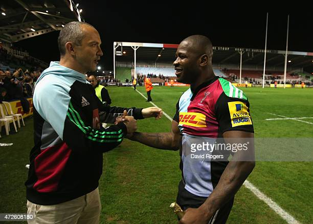 Ugo Monye shakes hands with director of rugby Conor O'Shea after his final home match for Harlequins during the Aviva Premiership match between...