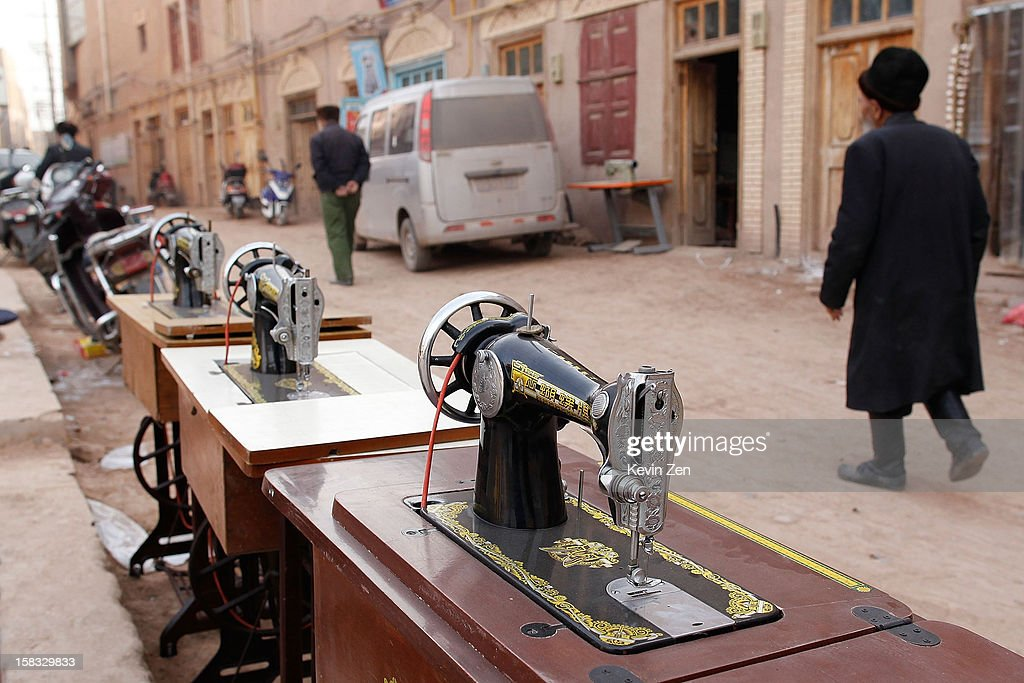 A Uighur man pass by a row of display in the streets to sell second-hand sewing machine in Kashgar, on December 10, 2012 in Kashi, China. Kashgar is home to the ethnic Uyghur Muslim community.