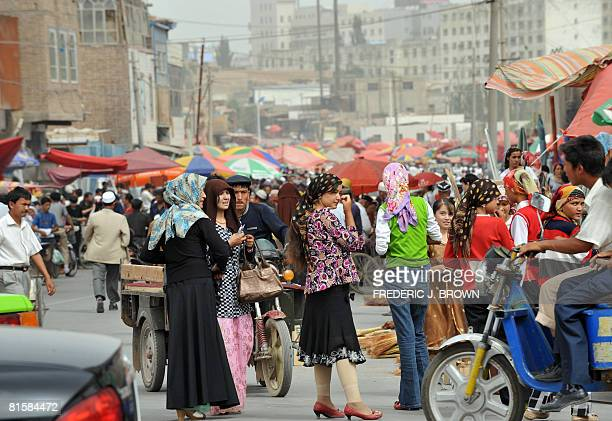 Uighur Muslims crowd the Sunday Bazaar in Kashgar on June 15 2008 in northwest China's Xinjiang Uighur Autonomous Region Once the sole outpost of...