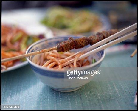 Uighur noodles and chuanr : Stock Photo