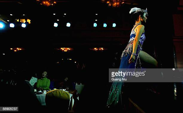 Uigur dancer performs at a restaurant on October 12 2005 in Urumqi city of Xinjiang Uyghur Autonomous Region China Xinjiang is one of China's...