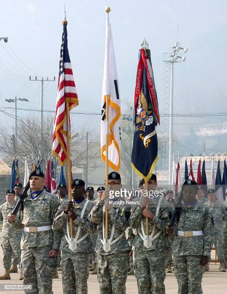 Uijeongbu South Korea The US Army 23rd chemical battalion holds a flagraising ceremony in Uijeongbu near Seoul on April 4 as the unit returned to...