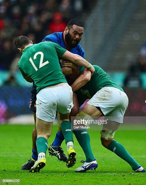 Uini Atonio of France is tackled by Robbie Henshaw and Mike McCarthy of Ireland during the RBS Six Nations match between France and Ireland at the...