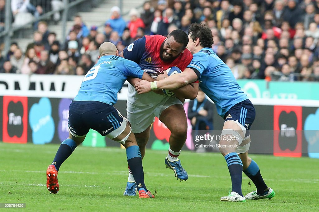 Uini Atonio #17 of France is tackled by Sergio Parisse #8 and Alessandro Zanni #7 of Italy during the RBS Six Nations game between France and Italy at Stade de France on February 6, 2016 in Saint Denis near Paris, France.