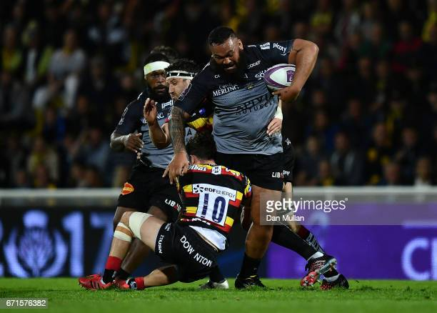 Uini Atonio of La Rochelle is tackled by Billy Burns and Jeremy Thrush of Gloucester during the European Rugby Challenge Cup Semi Final match between...
