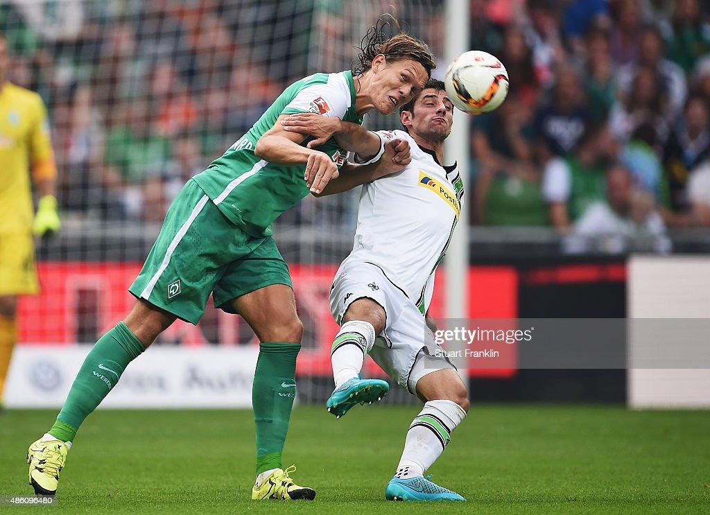 UJannik Vestergaard of Bremen is challenged by Lars Stindl of Gladbach during the Bundesliga match between Werder Bremen and Borussia...