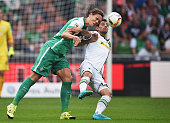 UJannik Vestergaard of Bremen is challenged by Lars Stindl of Gladbach during the Bundesliga match between Werder Bremen and Borussia...