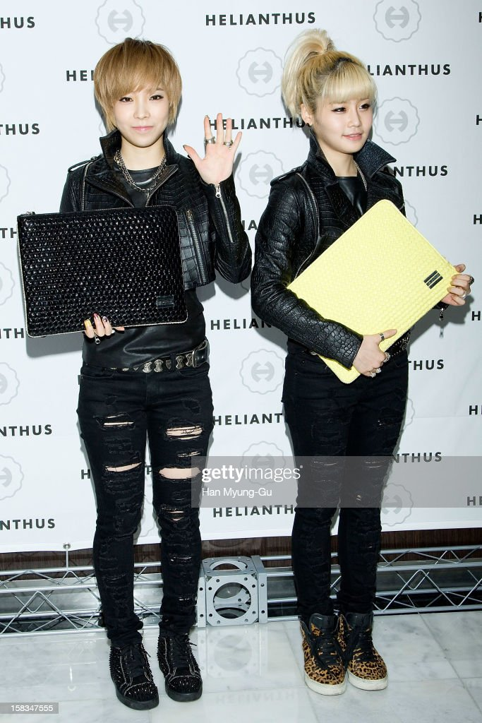 UJin and Ram of South Korean girl group DUnit attend a promotional event for the 'Helianthus' Flagship Store Opening at Lotte Duty Free Shop on...