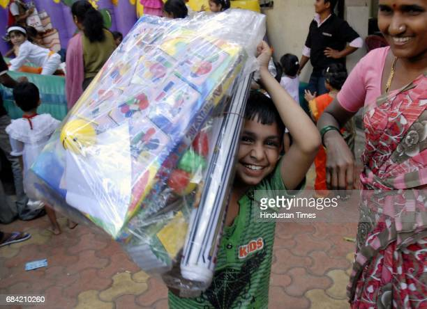 Ujwal Singh age 9 takes away his set of educational toys distributed at 'Joy in a Box' an yearly initaitive by 'Life Trust' NGO at a municipal school...