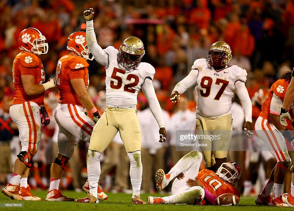 Ukeme Eligwe #52 of the Florida State Seminoles reacts after sacking <a gi-track='captionPersonalityLinkClicked' href=/galleries/search?phrase=Tajh+Boyd&family=editorial&specificpeople=7352415 ng-click='$event.stopPropagation()'>Tajh Boyd</a> #10 of the Clemson Tigers during their game at Memorial Stadium on October 19, 2013 in Clemson, South Carolina.