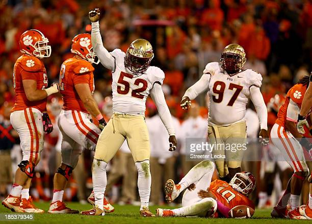 Ukeme Eligwe of the Florida State Seminoles reacts after sacking Tajh Boyd of the Clemson Tigers during their game at Memorial Stadium on October 19...