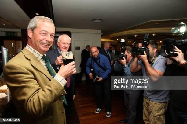 Ukip leader Nigel Farage joins Ukip MLA David McNarry for a pint at the Europa Hotel in Belfast